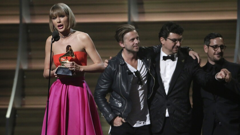Taylor Swift accepts record of the year trophy at 58th Grammy Awards in 2016.