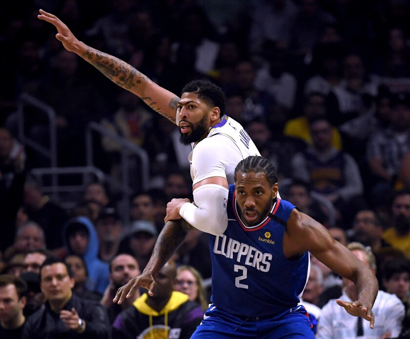 Clippers' Kawhi Leonard guards Lakers' Anthony Davis on Sunday at Staples Center.
