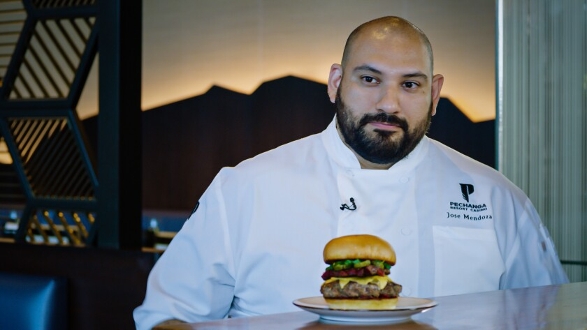 Chef Jose Mendoza poses with his Psycho-Deli Burger at the Lobby Bar & Grill at Pechanga Resort Casino