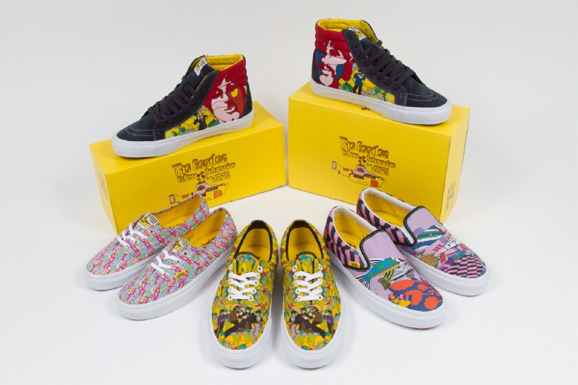 Four pairs of brightly colored, boldly patterned sneakers and two yellow shoeboxes.