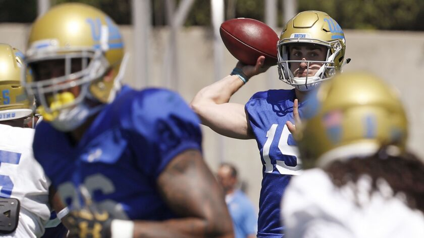 UCLA quarterback Matt Lynch throws downfield at Drake Stadium on April 21, 2018.