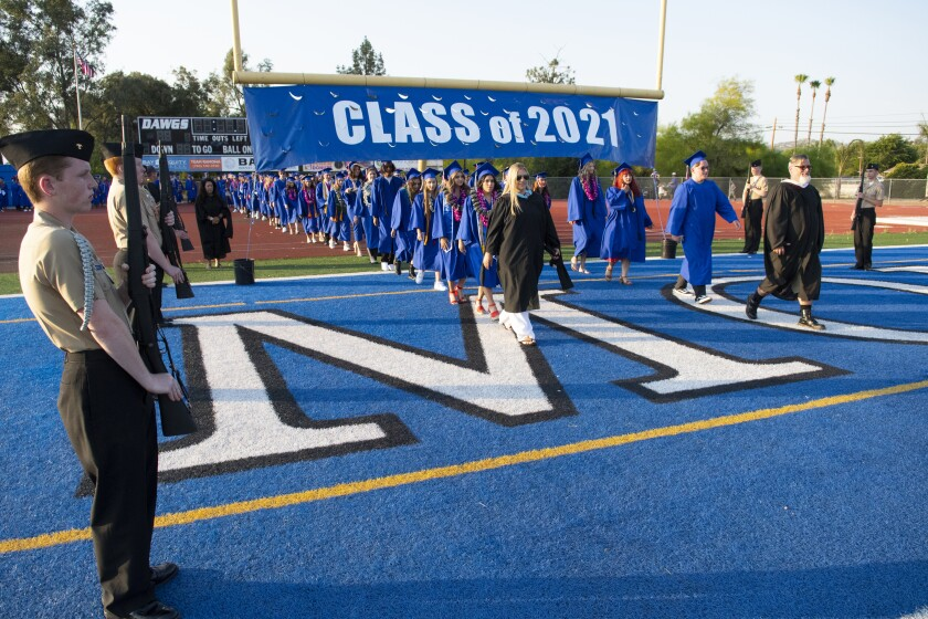 The Ramona High School Class of 2021 enters the football field for the June 17 commencement ceremony.
