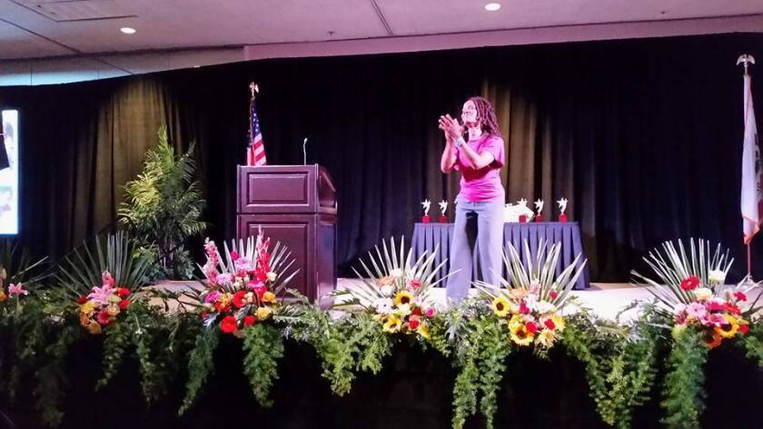 Dionne Thomas, a fitness instructor and inspirational speaker from Temecula, literally moves the crowd at Friday's San Diego East County Chamber of Commerce Women In Leadership Luncheon.