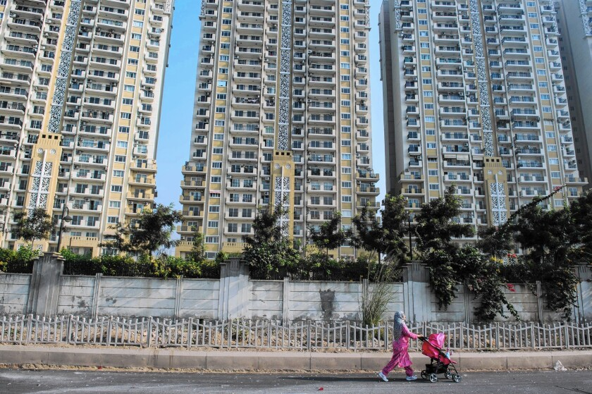 A new residential apartment building near New Delhi. The global population is expected to reach 8.5 billion by 2030.