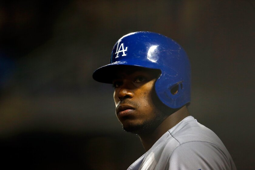 Dodgers' Yasiel Puig looks on against the New York Mets on Oct. 13.