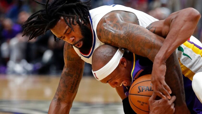 DeAndre Jordan battles New Orleans forward Dante Cunningham for the ball in the first half on Sunday in New Orleans. The Clippers won 112-103.