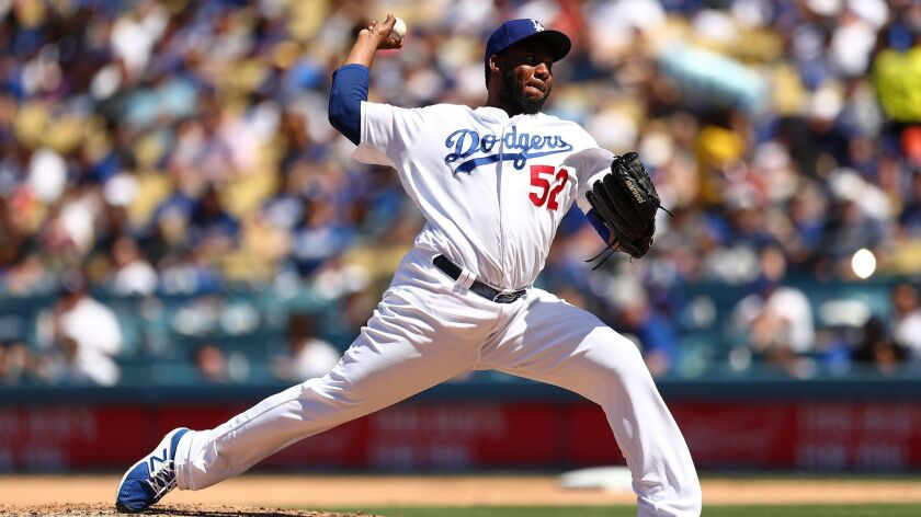 Pedro Baez delivers a pitch against the Cincinnati Reds on April 17. Baez's continued evolution as a pitcher has made him a reliable reliever for the Dodgers.