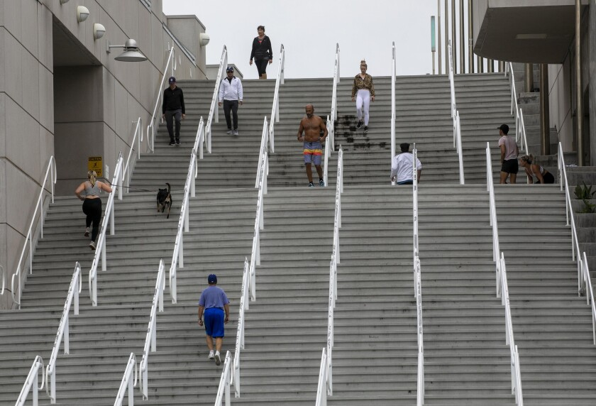 People kept their distance because of  COVID-19 while they exercised on the stairways at the Convention Center.