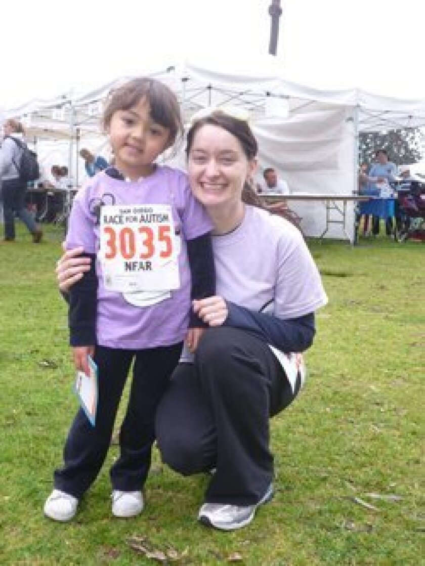 See Beneath co-founder Gerin Gaskin with Aiko, who inspired the animation of 'Aiko & Egor,' at the National Foundation for Autism Research's San Diego Race for Autism.