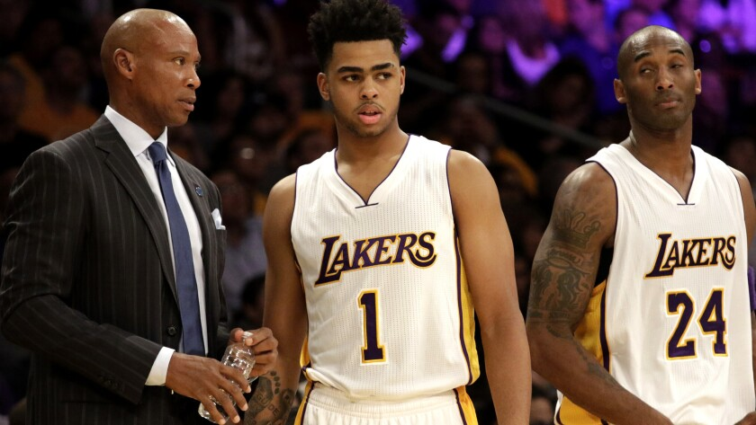Lakers Coach Byron Scott talks to rookie guard D'Angelo Russell with Kobe Bryant nearby during a game Nov. 1.