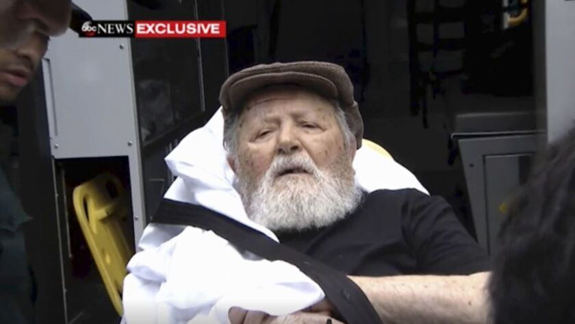 Jakiw Palij, a former Nazi concentration camp guard, is carried on a stretcher from his home in the Queens borough of New York on Monday.