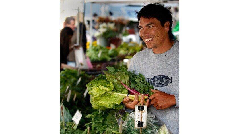 Romeo Coleman of Carpinteria mans the Wednesday Coleman Family Farm stand. He is taking over from his dad, Bill Coleman.