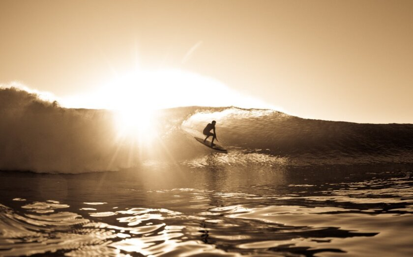 Photographer Marcio Canavarro's print of Jeff McCollum at Black's Beach is one of the auction items at the Surfrider Art Gala.