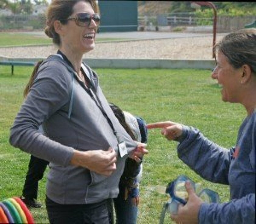 Splashed PTA President Sara McMenamin commiserates with Principal Lerner.