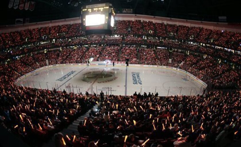 Fans attend Game 1 of a first-round NHL hockey Stanley Cup playoff series between the Anaheim Ducks and the Detroit Red Wings in Anaheim, Calif., Tuesday, April 30, 2013. (AP Photo/Chris Carlson)