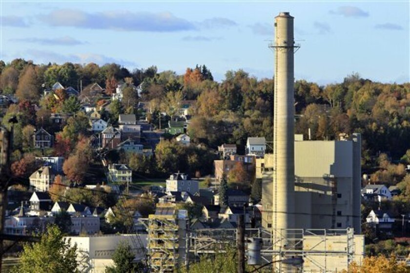 In this Sept. 27, 2012, photo. the smoke stack from the closed paper mill is seen in Berlin, N.H. Berlin is an economically hard hit town after loosing its paper mill. Mitt Romney is a part-time resident of tiny New Hampshire. His fiscally conservative, socially moderate tenure as governor of neighboring Massachusetts once seemed a good match for New Hampshire's independent and libertarian-leaning electorate. Yet, Romney trails President Barack Obama in polls in New Hampshire as he does in most other presidential battlegrounds despite spending considerable time and money to lock up the state's four Electoral College votes.(AP Photo/Jim Cole)