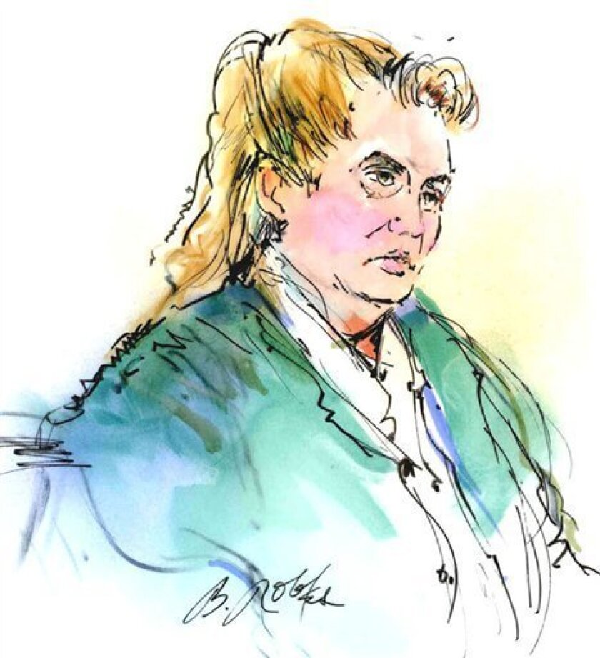 FILE - In this courtroom sketch, Dorothee Burkhart appears in federal court on fraud charges Tuesday Jan. 3, 2012 in Los Angeles. Burkhart is the mother of suspected Los Angeles arsonist Harry Burkhart. Burkhart is scheduled to again appear in federal court Friday Jan. 6,, 2012 on fraud charges. (AP Photo/Bill Robles, File)