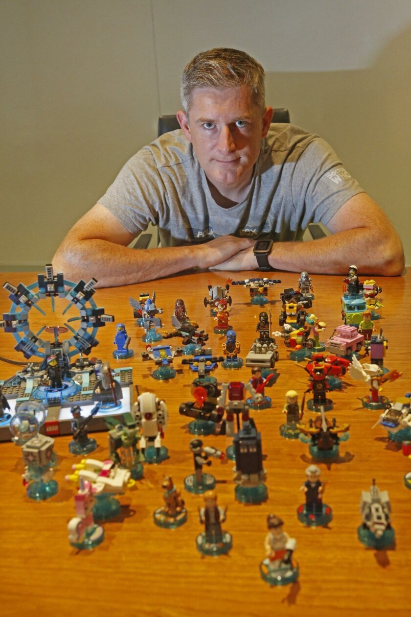 BURBANK, CA. - September 11, 2015:  Warner Brothers executive Jon Burton poses for a portrait with his Lego Dimensions toys at Warner Brothers in Burbank on September 11, 2015. Burton is co-founder and creative director of TT Games which is owned by Warner Brothers. (Anne Cusack/Los Angeles Times)