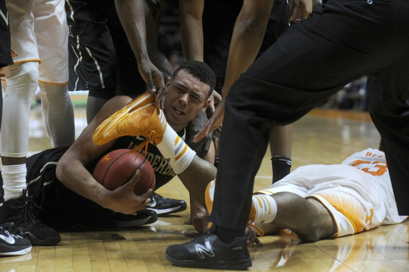 Vanderbilt guard Wade Baldwin IV (4) gets up after a foul is called against Tennessee during the first half of an NCAA college basketball game in Knoxville, Tenn., Thursday, Feb. 26, 2015. (AP Photo/Knoxville News Sentinel, Jessica Tezak)