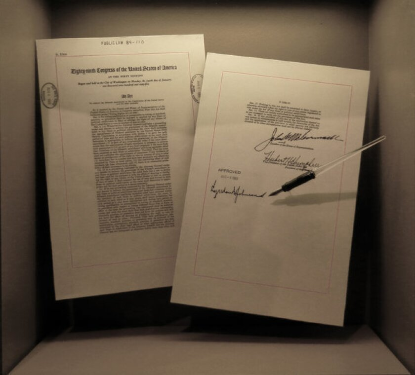 Items displayed at the International Civil Rights Museum include the 1965 Voting Rights Act, and the pen President Lyndon B. Johnson used when he signed it.