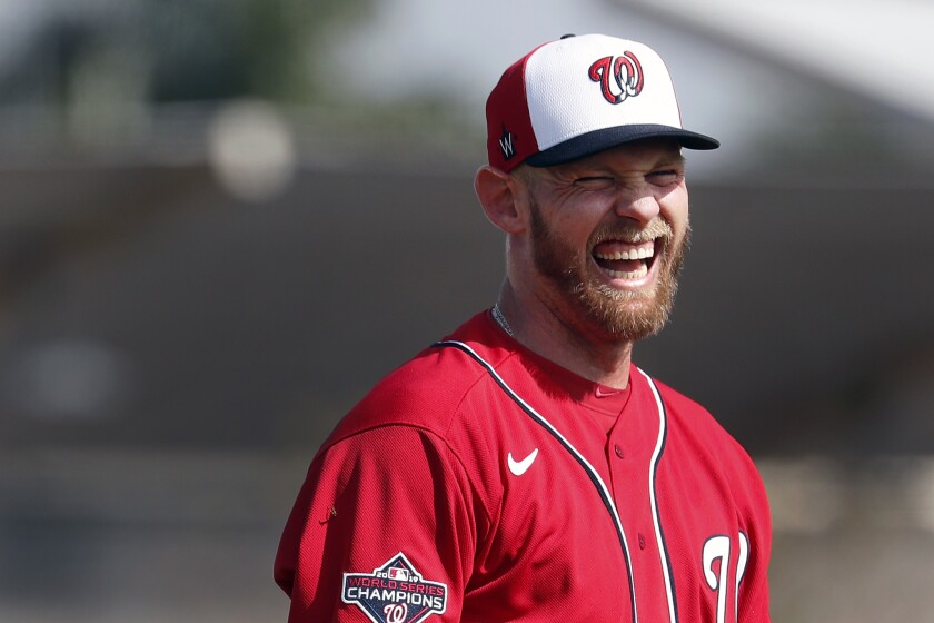 FILE - In this Feb. 14, 2020, file photo, Washington Nationals pitcher Stephen Strasburg laughs during spring training baseball practice in West Palm Beach, Fla. (AP Photo/Jeff Roberson, File)