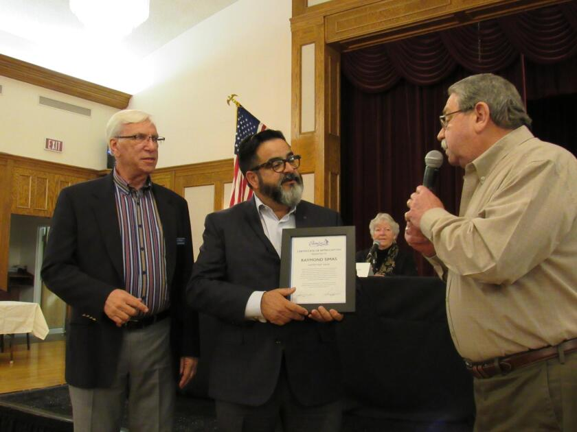 PLA treasurer Ted Walker (left) and PLA president Dave Martin present a community appreciation proclamation to Raymond Simas of Home Street Bank for its continued support and services.