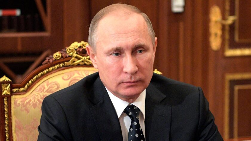Russian President Vladimir Putin attends a meeting in the Kremlin in Moscow on Jan. 10.