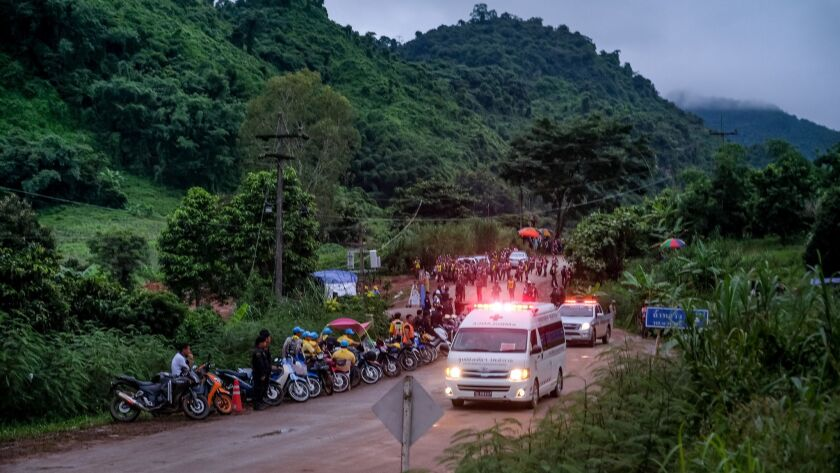 An ambulance carrying one of the boys rescued from the cave in northern Thailand heads toward a hospital in Chiang Rai.