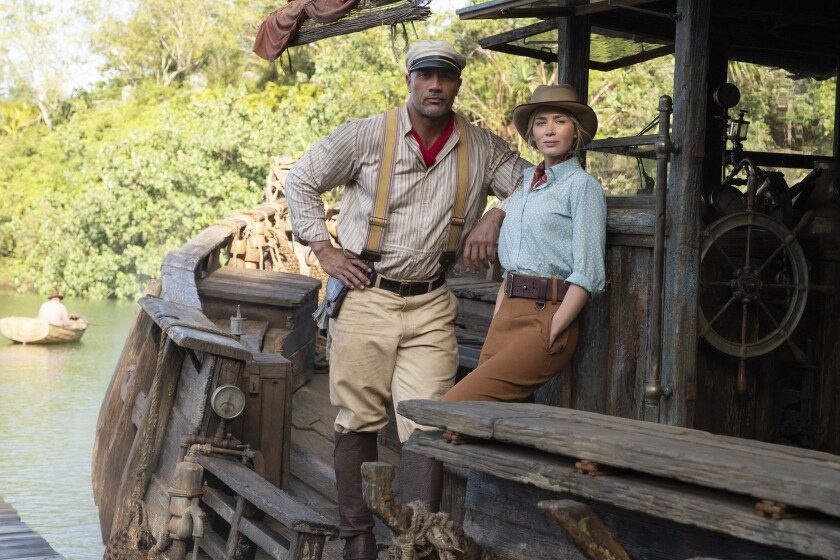 """Dwayne Johnson and Emily Blunt on a boat in """"Jungle Cruise."""""""