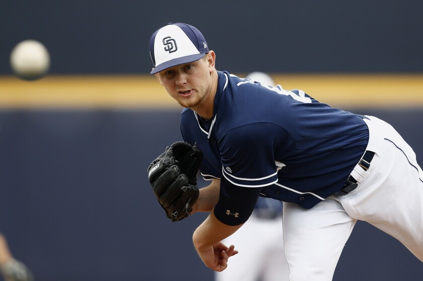 Padres starting pitcher Eric Lauer warms up prior to a spring training baseball game against the Cleveland Indians Saturday, March 10, 2018, in Peoria, Ariz. The game ended in an 8-8 tie.