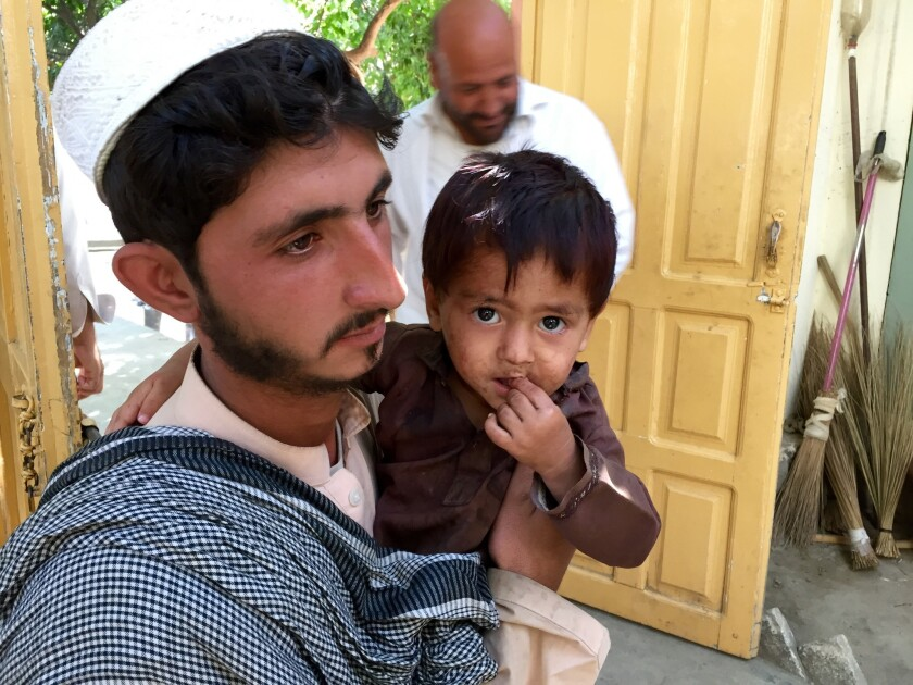 Zainullah, pictured with his uncle Mosanif, is one of four children from Afghanistan's remote Sheltan valley to be paralyzed by polio in 2016.