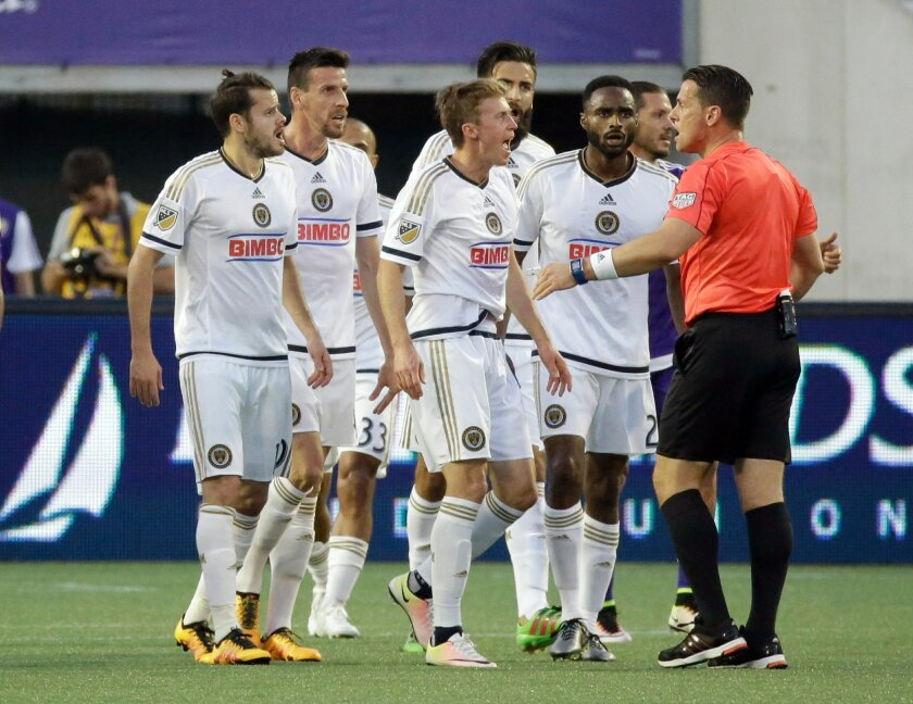 Philadelphia Union players dispute an ruling by an official during the first half of an MLS soccer game against Orlando City, Wednesday, May 25, 2016, in Orlando, Fla. (AP Photo/John Raoux)