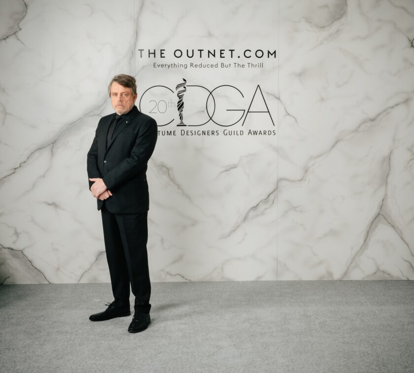 Presenter Mark Hamill is suited up for the Costume Designers Guild Awards.