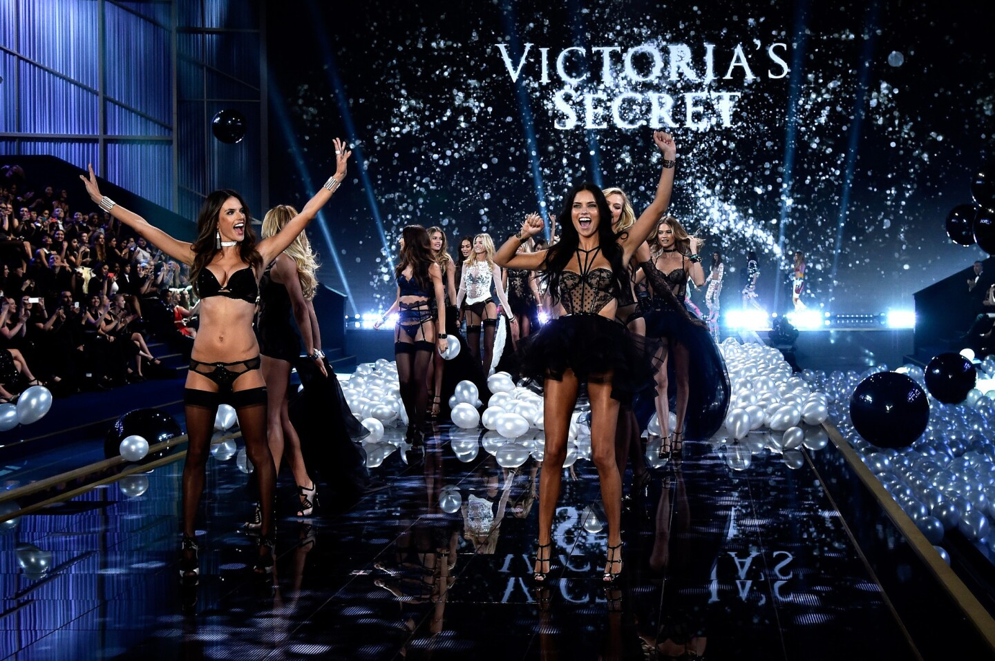 The models storm the runway at Earls Court in London at the 2014 Victoria's Secret Fashion Show.