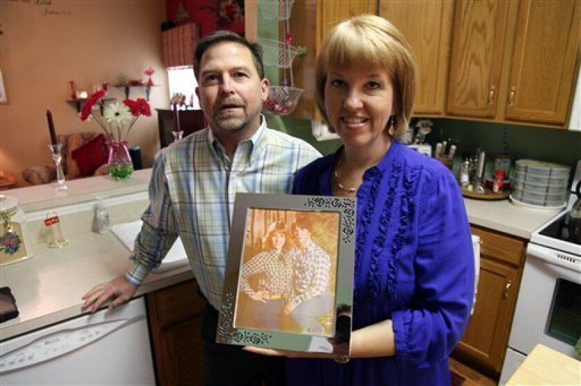 In this Oct. 19, 2012, photo, Ray and Candice Arvin pose inside their home in Charlotte, N.C. Romney supporter, Ray Arvin used to own a small business with five employees, selling equipment to power companies, but he went out of business in 2009. He's now a salesman for another equipment company. Polls consistently find that the economy is the top concern of voters, and Romney tends to get an edge over Obama when people are asked who might do better with it. Whether that truly drives how Americans vote is a crucial question for Election Day. (AP Photo/Robert Ray)