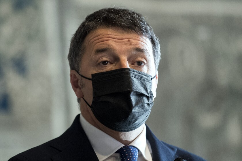 Former Italian Premier Matteo Renzi arrives to brief the media after meeting Mario Draghi at the Chamber of Deputies in Rome, Friday, Feb. 5, 2021. Mario Draghi has been working to secure the required backing in Parliament for him to govern. (Roberto Monaldo/LaPresse via AP)
