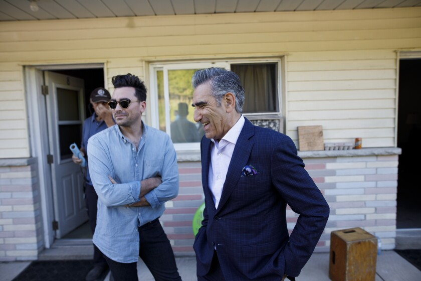 """Father and son Dan Levy, left, and Eugene Levy on the """"Schitt's Creek"""" set"""