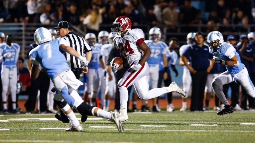 Monte Vista running back Jahmon McClendon goes for a touchdown in the Monarchs' semifinal win over University City.