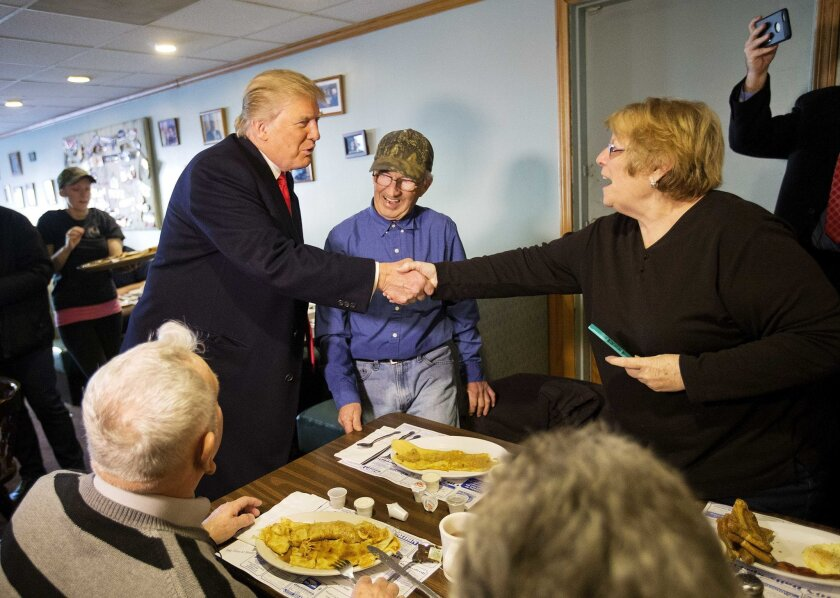 FILE - In this Sunday, Feb. 7, 2016, file photo, Republican presidential candidate Donald Trump, left, shakes hands with Elaine Chiechon while visiting the Chez Vachon restaurant in Manchester, N.H. Small business issues like taxes and regulations are expected to get more attention in the president