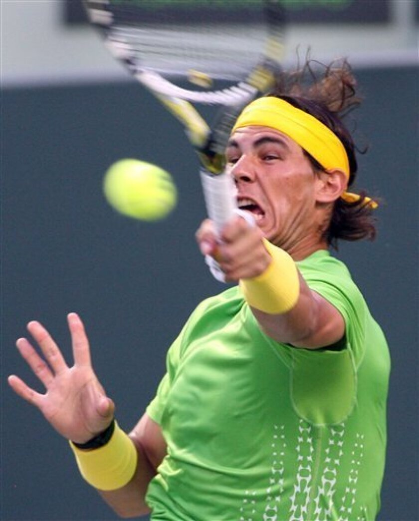 Rafael Nadal , of Spain, returns a ball to Tomas Berdych, of the Czech Republic, at the Sony Ericsson Open tennis tournament in Key Biscayne, Fla., Thursday, March 31, 2011. (AP Photo/Jeffrey M. Boan)