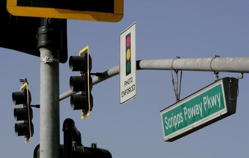 A sign warns motorists of red light cameras on northbound Community Road at Scripps Poway Parkway. (Charlie Neuman/Union-Tribune)
