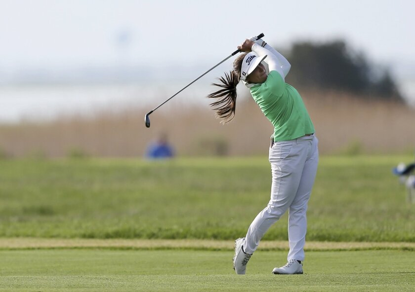 Mariajo Uribe, of Colombia, hits a fairway shot on the third hole of the second round of the ShopRite LPGA Classic golf tournament, Saturday, June 4, 2016, in Galloway Township, N.J.(AP Photo/Mel Evans)
