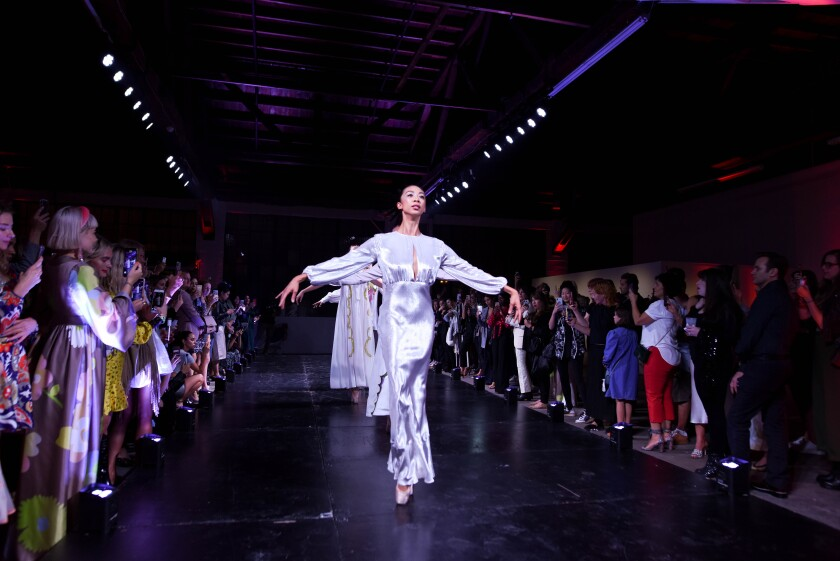 Members of the American Contemporary Ballet model looks by Cynthia Rowley by going down the runway en pointe.