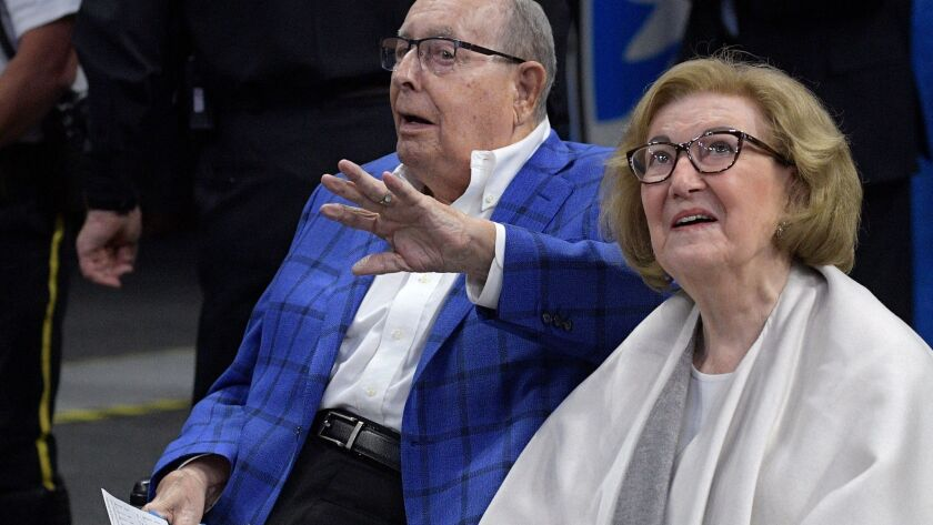 Helen DeVos and her husband Rich sitting courtside at an Orlando Magic game in March.