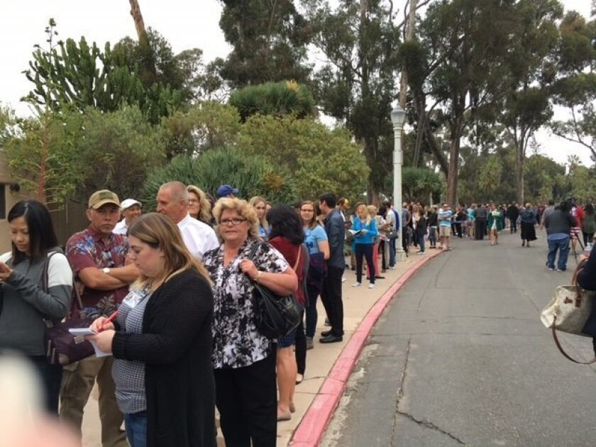 A long line of people waiting to see Bill Clinton speak formed outside the Balboa Park Club.