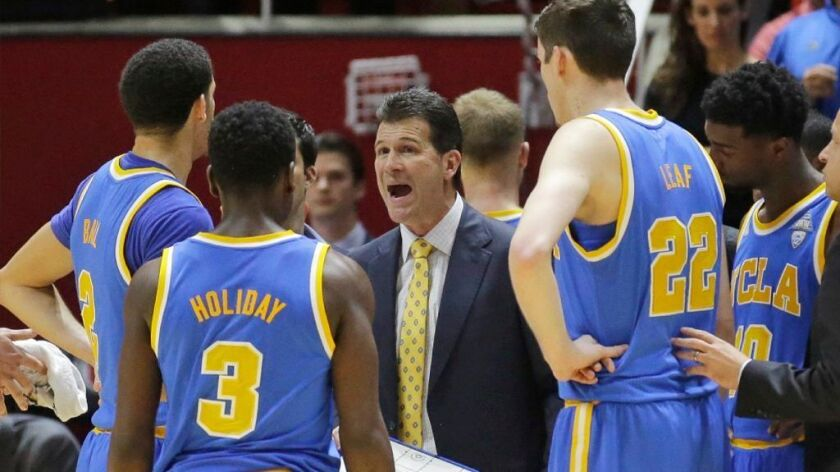 UCLA Coach Steve Alford speaks to his players during a timeout in the second half of a game against Utah on Saturday.