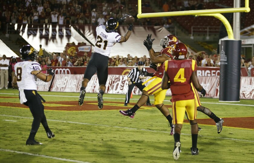 """Arizona State's Jaelen Strong catches a 49-yard """"hail mary"""" pass from Mike Bercovici to defeat USC on the final play of the game on Saturday, Oct. 4, 2014 at Memorial Coliseum in Los Angeles, CA. (AP Photo/The Arizona Republic, Rob Schumacher)"""