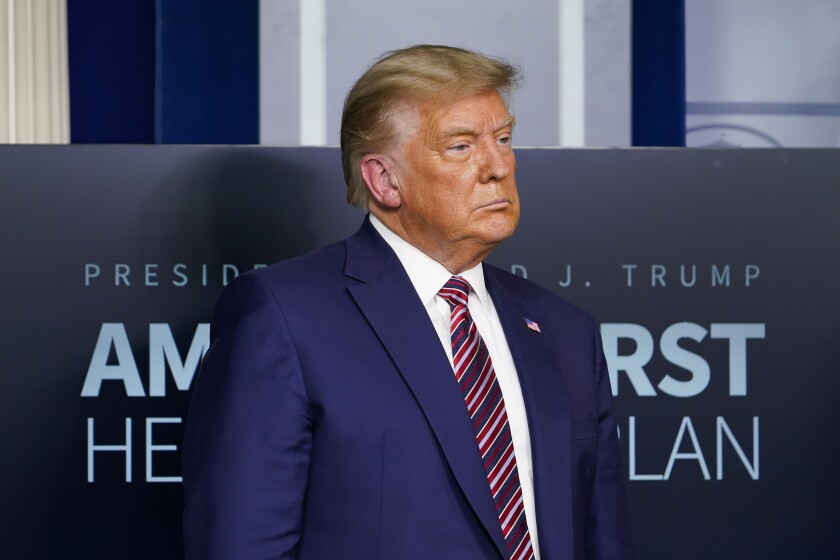 President Trump listens during a news conference