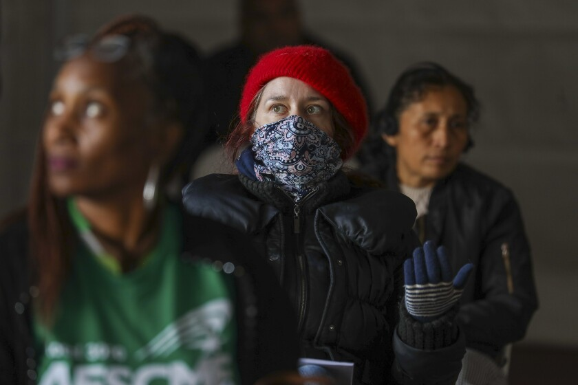 Rachel Carlson watches a Los Angeles City Council meeting  amid fears about the rapidly spreading coronavirus.