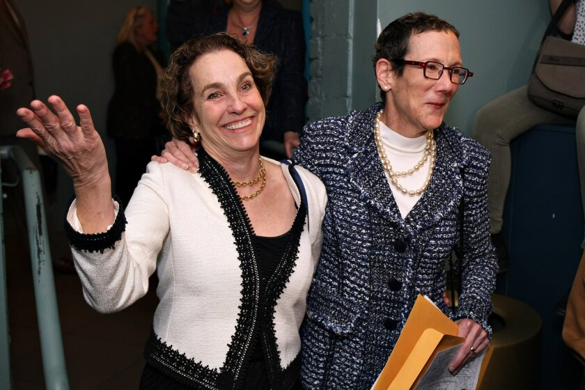 Suzanne Bryant, left, and Sarah Goodfriend celebrate after being granted a marriage license in Austin on Thursday. On Friday, the state attorney general sought to void their license.